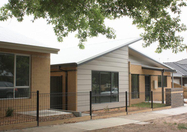 Photo of block of social housing units